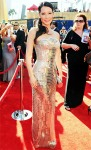 Lucy Liu in a gold Versace metal gown with Giuseppe Zanotti clutch & Lorraine Schwartz jewelry.