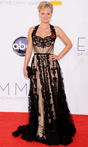 Martha Plimpton in a black overlay lace Christian Siriano gown with Fred Leighton jewelry & a black Rene Caovilla clutch.