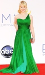 Melissa Rauch in a one-shoulder multi color Oliver Tolentino gown with a Rebecca Minkoff minaudiere.