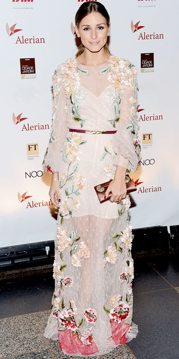 Olivia Palermo in an embroidered Valentino gown with pearl studs & a satin clutch.