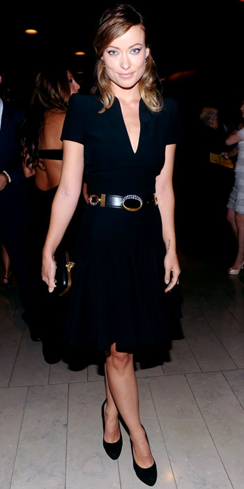 Olivia Wilde in a plunging black Alexander McQueen dress with drop earrings by Little H for Pearl Collective, & a lapis House of Lavande cocktail ring.