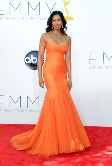 Padma Lakshmi in a strapless sweetheart peach Monique Lhuillier gown