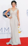Sarah Hyland in a silver Notte by Marchesa gown with a Judith Leiber clutch & Lorraine Schwartz earrings.