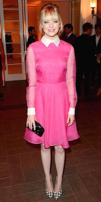Emma Stone in a collard pink dress & clutch by Valentino with stacked Irene Neuwirth gold rings, & houndstooth Ferragamo pumps.