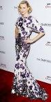 Naomi Watts in a floral mermaid Zac Posen gown with a gold Jennifer Meyer lizard cuff, & sapphire J. Hadley drop earrings.