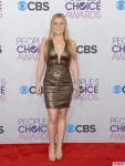 Alison Sweeney in a plunging gold mini dress.