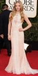 Amanda Seyfried in a nude lace gown by Givenchy.