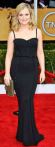 Amy Poehler in a black lined Zuhair Murad gown with jewelry by Forevermark