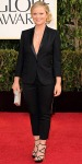 Amy Poehler in a black slim leg suit by Stella McCartney with a diamond lariat & strappy sandals.