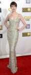 Anne Hathaway in a shimmery, spiral-textured slip dress by Oscar de la Renta.