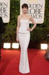 Anne Hathaway in a white strapless peplum embellished gown by Chanel