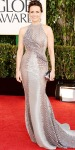 Carla Gugino in a silver halter gown by Rami Al Ali with statement earrings & metallic clutch