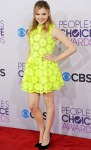 Chloe Grace Moretz in a neon yellow daisy print dress from Simone Rocha's Spring 2013 Collection.