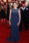 Edie Falco in a navy overlay sparkling sleeveless gown by Chagoury