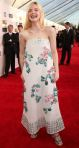 Elle Fanning in a flower embellished strapless Chanel gown.