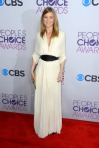 Ellen Pompeo in a cream three-quarter leather belted Lanvin dress