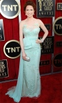 Ellie Kemper in a sea foam gown by Reem Acra with a Swarovski clutch & Neil Lane jewelry.