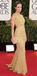 Emily Blunt in a gold cut-out Michael Kors gown with Salvatore Ferragamo box clutch.