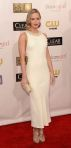 Emily Blunt in a white sequin-trimmed Miu Miu dress with strappy metallic sandals.