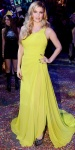 Fergie in a chartreuse asymmetric gown by Oliver Tolentino with statement earrings & jewelry pumps.