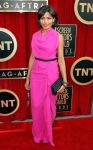 Freida Pinto in a pink belted Roland Mouret gown with bangles & a black clutch