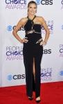 Heidi Klum in a black & gold Julien Macdonald cut-out dress with Lorraine Schwartz jewelry & Louboutin pumps.