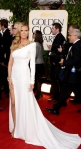 Heidi Klum in a white & gold single-sleeve Alexandre Vauthier gown