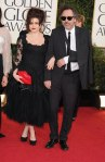 Helena Bonham Carter in a black floral-embellished lace dress with a clutch by Lulu Guinness