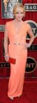 Jane Krakowski in a shimmering coral column gown by Kaufmanfranco