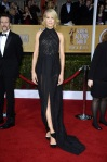 Jenna Elfman in a black slitted halter gown with black & white shoes