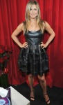 Jennifer Aniston in a black leather Christian Dior dress with strappy Tom Ford heels & Chanel purse.