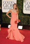 Jessica Alba in a coral sweetheart gown by Oscar de la Renta