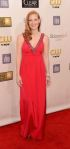 Jessica Chastain in a red neckline-embellished Prada gown with stacked bangles.