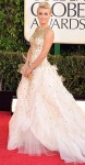 Julianne Hough in a white & gold Monique Lhuillier ballgown with a gold clutch.