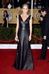 Julie Bowen in a black leather shoulder-embellished gown by Joanna Johnson