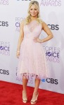 Kaley Cuoco in a pale pink Christian Siriano dress with rose gold jewelry by Dana Rebecca Designs & Giuseppe Zanotti wedges.