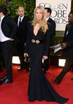 Kate Hudson in a black & gold-embellished open-front Alexander McQueen long-sleeved gown