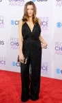 Katie Cassidy in a black plunging sparkling jumpsuit.