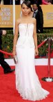 Kerry Washington in a white embellished Rodarte gown with vintage Fred Leighton jewelry.