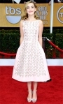 Kiernan Shipka in a pale pink Oscar de la Renta cocktail dress with silver ankle sandals.