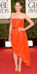 Marion Cotillard in an orange bespoke belted Dior dress with matching stilettos
