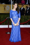 Mayim Bialik in a blue lace belted three-quarter sleeve gown