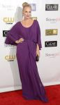 Molly Sims in a deep purple belted flowing gown.