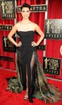 Morena Baccarin in a black sheer & print paneled Basil Soda gown