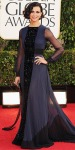 Morena Baccarin in a naby & black floor-length Valentino gown with retro waves & chandelier earrings.
