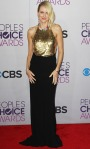 Naomi Watts in a black & gold floor length Alexander McQueen gown with Jennifer Meyer earrings & Jimmy Choo heels.