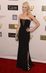 Naomi Watts in a sexy black Emilio Pucci gown.