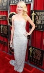 Naomi Watts in a silver embellished sweetheart gown by Marchesa