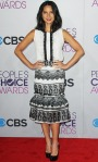 Olivia Munn in a sleeveless black & white Carolina Herrera design with pointed Christian Louboutin heels.