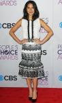 Olivia Munn in a sleeveless black & white Carolina Herrera design with pointed Christian Louboutin heels.